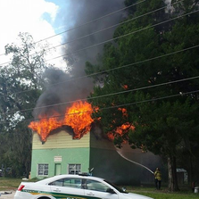 An image provided by the Union County Sheriff's Office shows flames bursting from the roof and smoke towering over a building in Lake Butler.