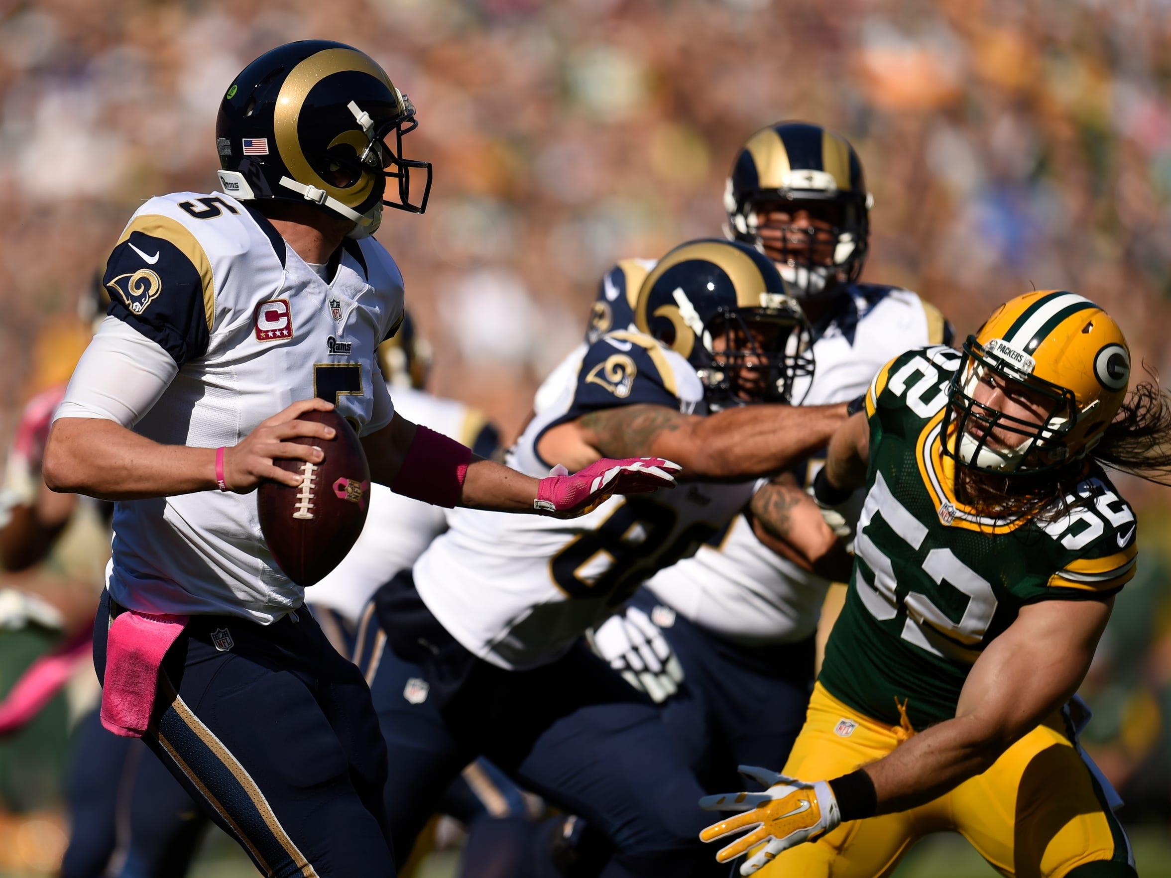 St. Louis Rams quarterback Nick Foles is pressured by Green Bay Packers inside linebacker Clay Matthews (52) at Lambeau Field.