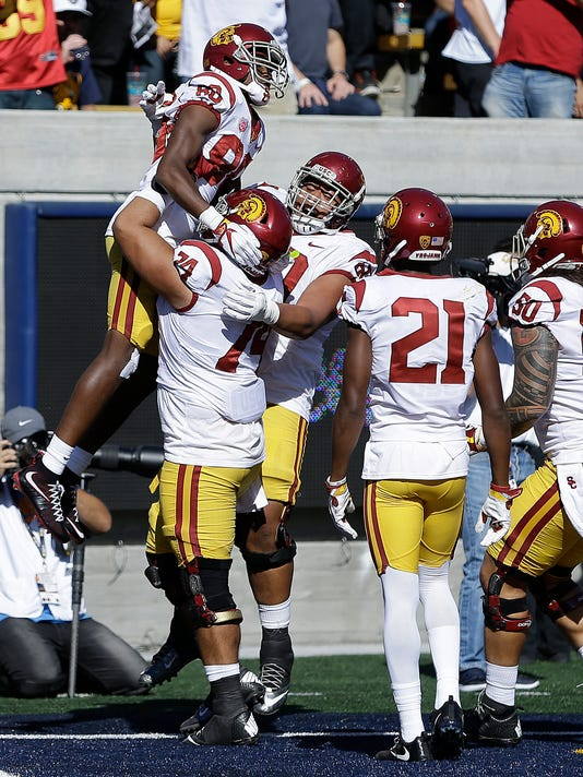 Southern California's Deontay Burnett, top left, celebrates with teammates after scoring a touchdown against California during the second half of an NCAA college football game, Saturday, Sept. 23, 2017, in Berkeley, Calif. (AP Photo/Ben Margot)