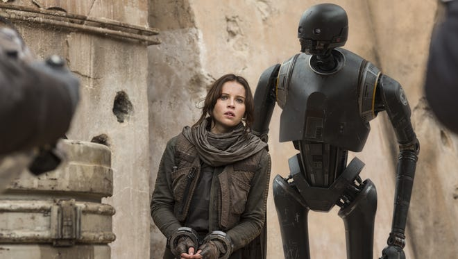 "Jyn Erso (Felicity Jones) and the droid K-2SO (Alan Tudyk) are part of a Rebel group trying to steal plans for the Death star in ""Rogue One: A Star Wars Story."""
