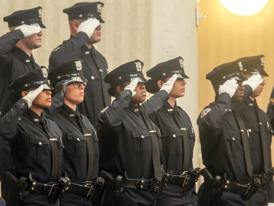 Members of the 97th Wilmington Police Academy Graduating class march into the riverfront ballroom Thursday, Feb. 10, 2017, at Chase Center On The Riverfron