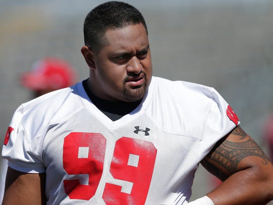 Wisconsin Badgers nose tackle Olive Sagapolu will have