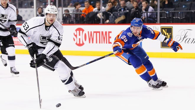 Kevin Gravel of the Los Angeles Kings, left,  skates against Brock Nelson of the New York Islanders during their game at the Barclays Center on Feb. 11.