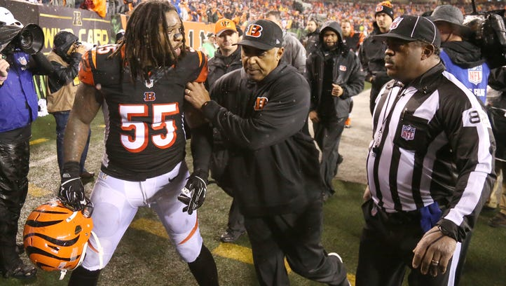 Cincinnati Bengals outside linebacker Vontaze Burfict (55) is restrained by Cincinnati Bengals head coach Marvin Lewis as he gestures toward an official at the conclusion of the AFC Wild Card Round game. The Steelers defeated the Bengals, 18-16.