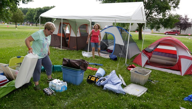 "Lani Nummerdor of Waupun and Gwen Loomans of Brandon set up their tents Wednesday, July 5, 2017, in the camping area of Lifest. Known as ""A Party with a Purpose,"" the annual event is Wisconsin's largest Christian music festival. Lifest 2017 runs June 6-9 at the Sunnyview Expo Center in Oshkosh."