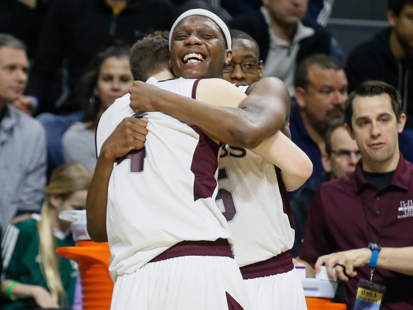 U-D Jesuit's Cassius Winston celebrates with Matt Schearer after the Cubs' 69-49 win over North Farmington in the Class A state championship in March.