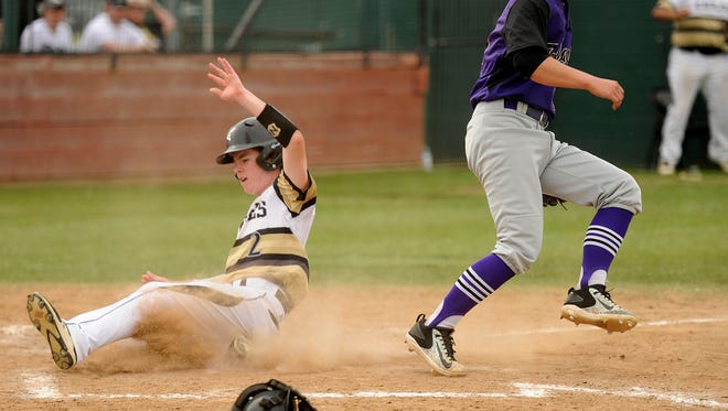 Abilene High's Ethan Flanders (2) scores on a wild pitch past Keller Timber Creek pitcher Chandler Paul during the bottom of the fifth inning of the Eagles' 7-3 win on Friday, April 28, 2017, at AHS's Blackburn Field.