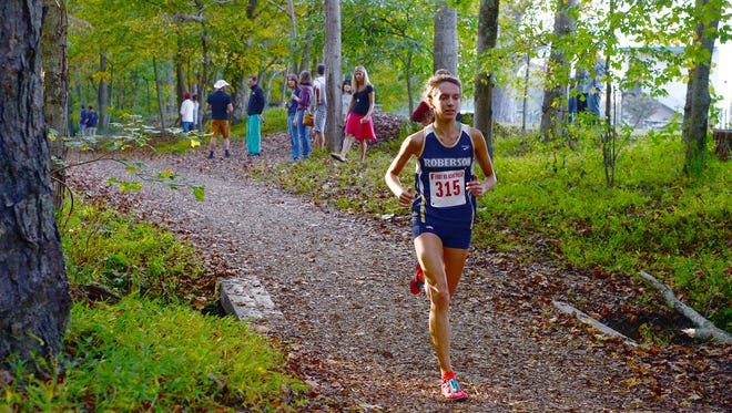 Roberson's Elise Wright was the girls winner at Monday's Mountain Athletic Conference cross country meet in Swannanoa.
