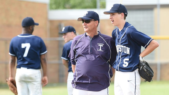 Redford Thurston baseball coach Bob Snell talks to pitcher Kenneth Rozmys during a recent game.