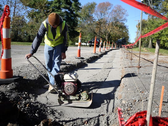 Workers put in a sidewalk on Gale Lane between Granny