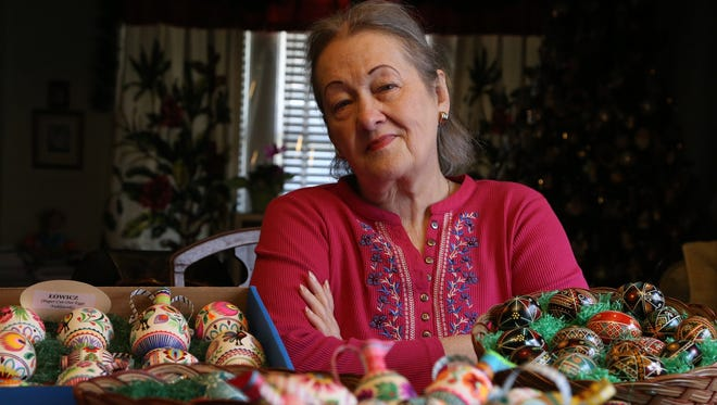Marcia Lewandowski of Detroit shows off a variety of Easter eggs in her Detroit home on Wednesday, April 1, 2015.