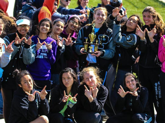 Plymouth celebrates winning the third-place trophy at Saturday's P-CEP girls tennis invite.