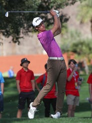 Palm Desert High School senior Charlie Reiter tees off on the 2nd hole at the La Quinta Country Club during the CareerBuilder Challenge, January 18, 2018.