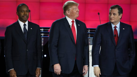 Republican presidential candidates Ben Carson, Donald Trump and Ted Cruz stand on stage during the CNN Republican presidential debate on Dec. 15, 2015, in Las Vegas.