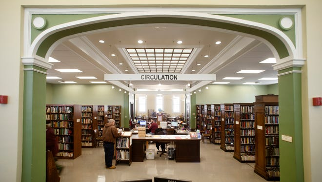 The circulation desk in the newly renovated Perth Amboy Public Library, Monday, October 19, 2015.