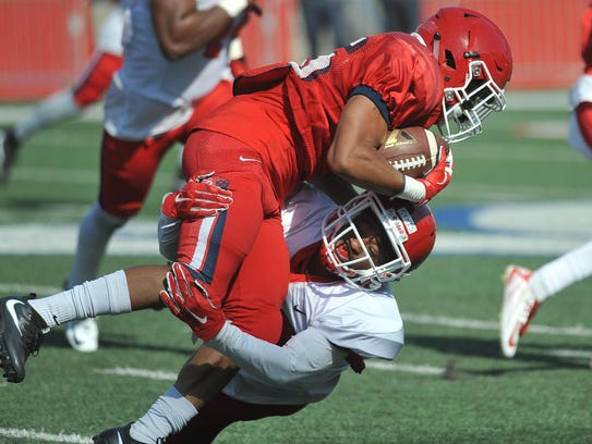 Defensive back Jerrell Sykes makes a tackle during