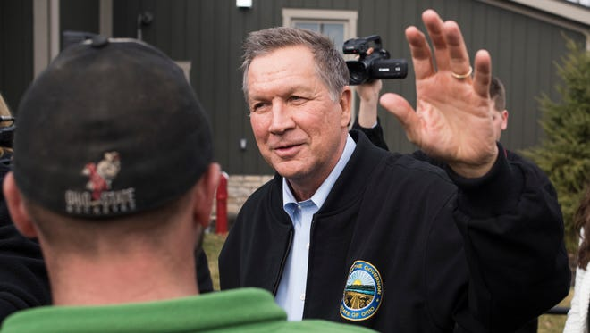 Ohio Governor John Kasich on March 6, 2016,  greets members in the crowd during a campaign rally at the Wells Barns at the Franklin Park Conservatory in Columbus, Ohio.