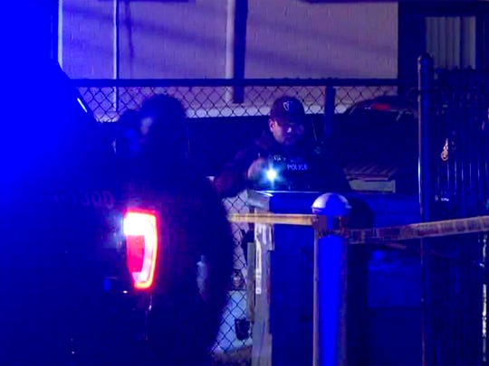Police investigate the scene of a multiple shooting