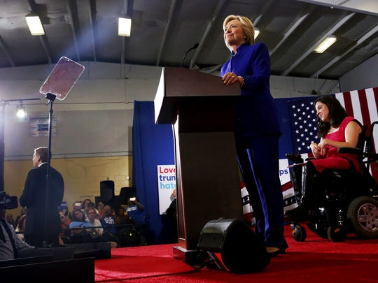 Hillary Clinton addresses the crowd during a rally at the Frontline Outreach and Youth Center in Orlando on Wednesday, Sept. 21, 2016.