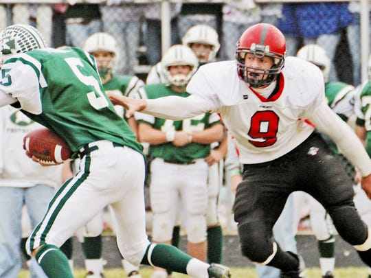 JJ Watt tackles a player from Kewaskum during his days at Pewaukee High School.