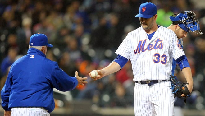 New York Mets manager Terry Collins takes the ball from starting pitcher Matt Harvey during the sixth inning against the Atlanta Braves at Citi Field Tuesdasy night. The Braves defeated the Mets 3-0.