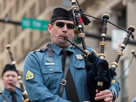 The Delaware State Police Pipe and Drums march in the Wilmington St. Patrick's Day parade on King Street in Wilmington last year.