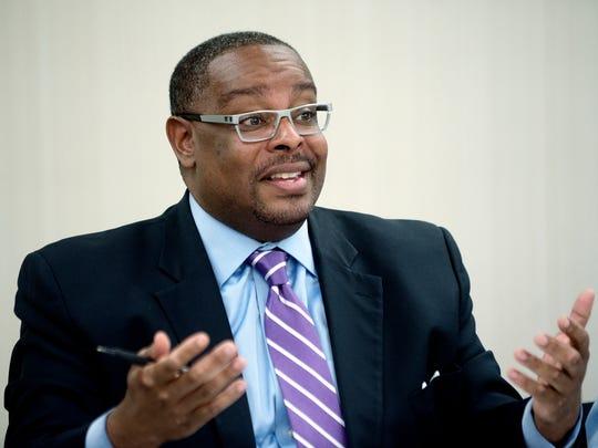 Lansing Housing Commission board president Tony Baltimore