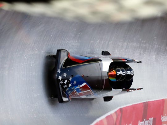 Driver Codie Bascue, Steven Langton, Samuel Mc Guffie and Evan Weinstock of the United States take a curve during training for the four-man bobsled competition at the 2018 Winter Olympics in Pyeongchang, South Korea, Friday, Feb. 23, 2018. (AP Photo/Andy Wong)