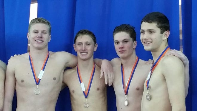 The Tuscola boys swimming team set school records in the 200-yard and 400-yard freestyle relays on Saturday.