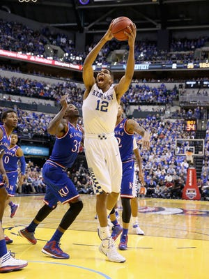 INDIANAPOLIS, IN - NOVEMBER 18:  Karl-Anthony Towns #12 of the Kentucky Wildcats shoots the ball during the game against the Kansas Jayhwaks in the State Farm Champions Classic at Bankers Life Fieldhouse on November 18, 2014 in Indianapolis, Indiana.  (Photo by Andy Lyons/Getty Images)