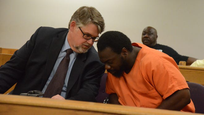 Attorney Niels Magnusson talks with Jerrell Finch in court Friday.