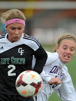 Clear Fork's Kaylin Helinski and Ontario's Amanda Nething battle for the ball during the girls soccer district championships at Ashland High School.