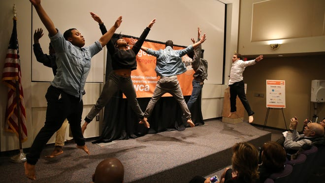Members of the TruArt Dance Company perform Wednesday at the YWCA's annual Stand Against Racism event at the Rochester Museum and Science Center. The community-wide event raises awareness about racism.