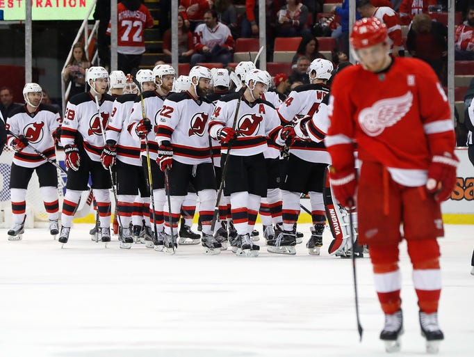 New Jersey Devils players celebrates their 4-3 win