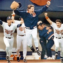 Minnesota Twins pitcher Jack Morris, center, leads the charge out of the dugout as the Twins win the World Series with a 1-0 victory over the Atlanta Braves in Game 7 at the Metrodome in Minneapolis on Oct. 27, 1991. Morris pitched a 10-inning shutout, landing the Twins their second World Series title.  (Pioneer Press: Jean Pieri)   (Pioneer Press: Jean Pieri)