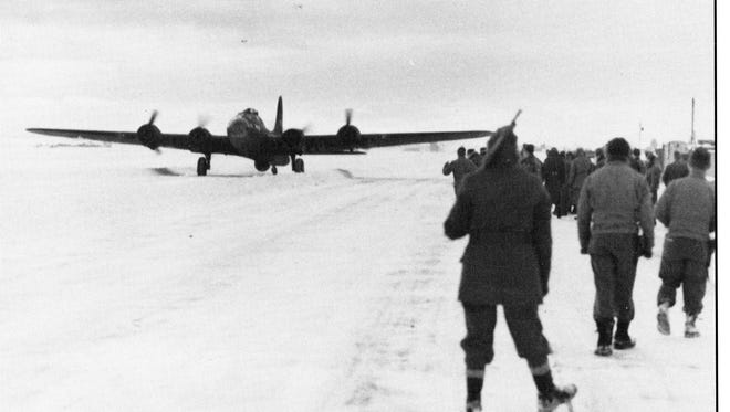 Spectators watch as Great Falls Army Air Base's first B-17 lands on the runway on November 30, 1942.