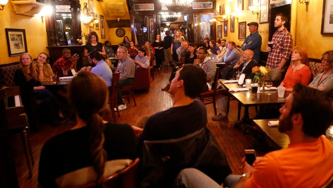People fill a room at Catherine Rooney's in Wilmington's Trolley Square to watch the Democratic candidates for president debate Tuesday night.