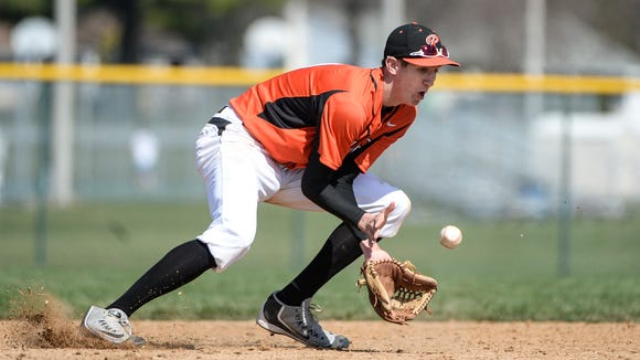 Palmyra's Isaac Blatt makes a play on a ground ball as Palmyra beat Cedar Crest 10-5 at Palmyra on Saturday, March 26, 2016.