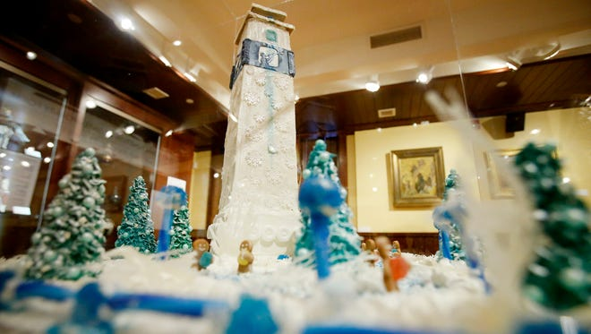 Little Joe Tower stands tall over a winter scene of evergreens, gingerbread men and a stream of water. The gingerbread creation is an entry in the Rockwell Museum's Gingerbread Invitational contest.