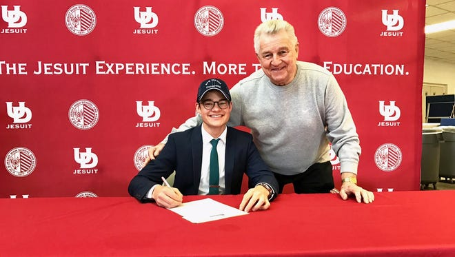 Ryan Garchar (left) shares National Signing Day with his grandpa and golf mentor, Steve Garchar. Ryan, a senior at University of Detroit Jesuit, signed to golf at Ave Maria University.