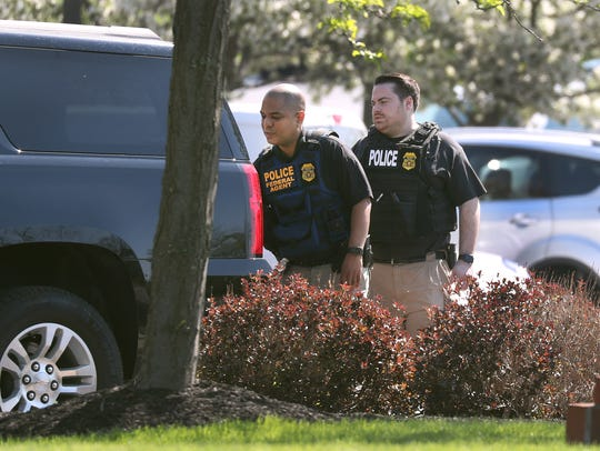 Federal agents leave the offices of Morgan Management