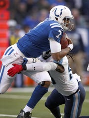 Indianapolis Colts quarterback Jacoby Brissett (7) is sacked by Tennessee Titans linebacker Erik Walden (93) in the first half of their game at Lucas Oil Stadium Sunday, Nov. 26, 2017.