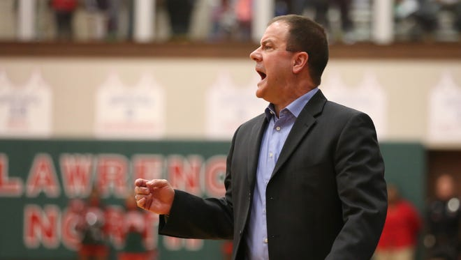 FILE – Carmel coach Scott Heady calls out to his team against Lawrence North at Lawrence North Friday February 6, 2015. Carmel won 52-49.