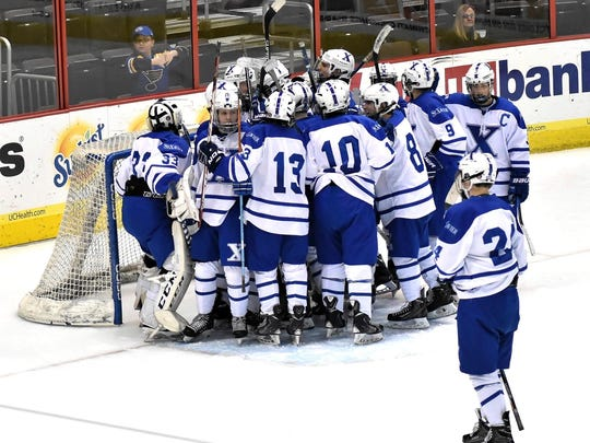 The St. Xavier Ice Hockey Bombers celebrate their victory at US Bank Arena over rival Moeller, Dec. 14, 2017.