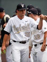 Vanderbilt pitcher Ryan Johnson (31) greets teammates