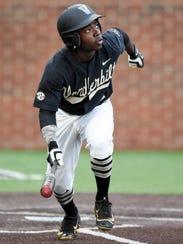Vanderbilt infielder Ro Coleman (1) watches as he flies