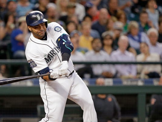 Seattle Mariners' Nelson Cruz singles in a run against the Baltimore Orioles in the fourth inning of a baseball game Tuesday, Aug. 15, 2017, in Seattle. (AP Photo/Elaine Thompson)