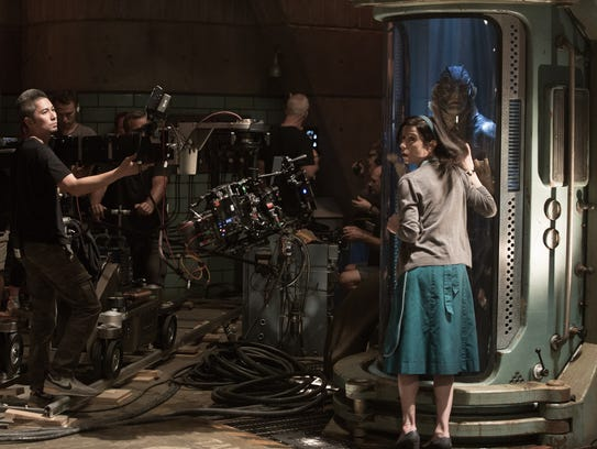 Sally Hawkins and Doug Jones (in tank) on the set of