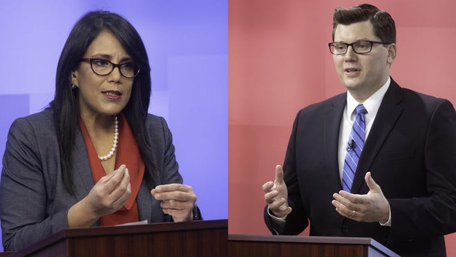 Candidates for the 2nd Congressional District seat Topeka Mayor Michelle De La Isla, left, and State Treasurer Jake LaTurner debate Wednesday evening at KSNT News studio at 6835 N.W. US-24 highway.