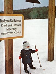 A young skier waits for a lesson. This photo was used in the Madonna Mountain promotional brochure for the 1972-73 winter season. The ski area at that time encompassed 27 trails spread over Morse, Madonna and Sterling mountains, and a growing village at the base of Morse Mountain.